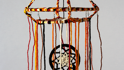 "Judy Phillips, ""Finding Balance Together"", Yarn, wooden and metal hoops, beads, and wire, 3D art about 15-inch diameter and 24 inches tall"