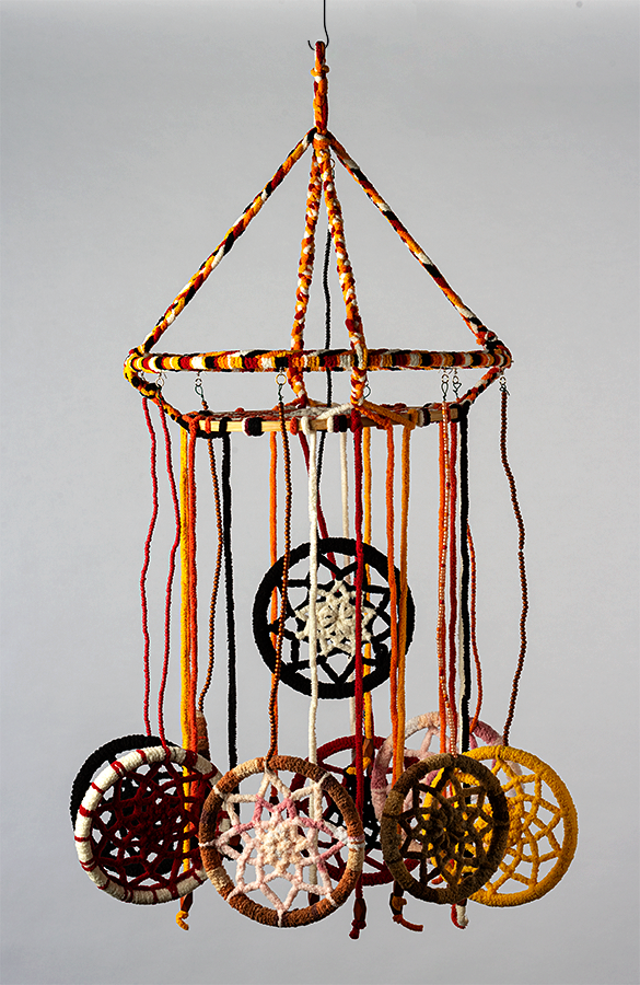 """Judy Phillips, """"Finding Balance Together"""", Yarn, wooden and metal hoops, beads, and wire, 3D art about 15-inch diameter and 24 inches tall"""